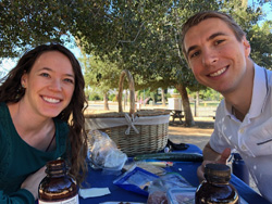 Bradley Lubich and a friend at a picnic in a park