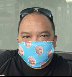 Jose Tagunicar wearing a mask printed with pictures of himself wearing a mask