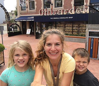Woman with her young daughter and son in front of Ghirardelli store