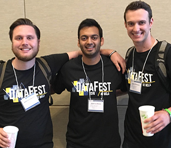 Three students in black DataFest t-shirts