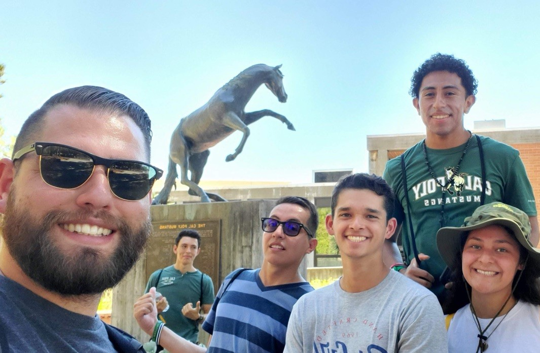 group of students in front of University Union mustang statue