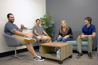 4 students sitting in the transfer center smiling