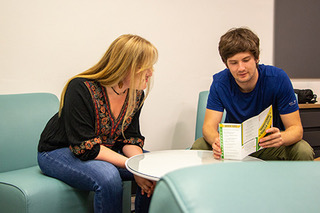 two students sitting together looking at a paper titled Quarter Transition