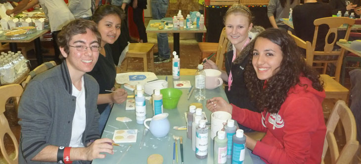 Students painting ceramic printers