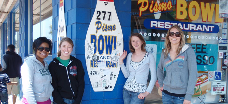 Students posing next to the Pismo Bowl sign