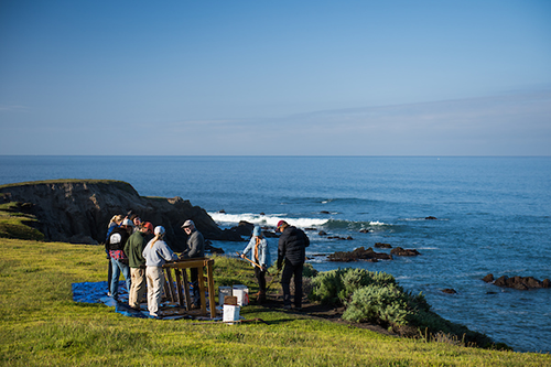 Archaeological Field Methods take part in a Learn by Doing activity near the Pacific Ocean.
