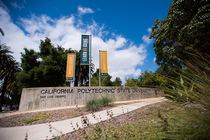 "Banners reading ""Learn by Doing. Welcome, Mustangs."" greet campus visitors arriving on California Blvd."