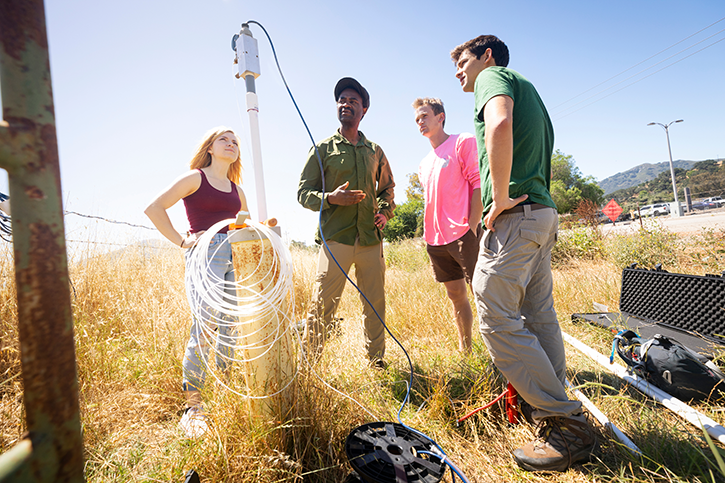 Cal Poly students monitor a well on campus with Dr. Bwalya Malama. This class is one of many instances of the university's signature Learn by Doing pedagogy.
