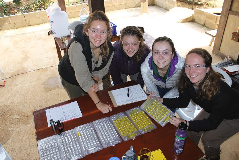 Kimberly Pugel (ENVE), Michallynn Hoffman (IE), Stefania Beauchamp (SE), and Abigail Nial (MATE) with water quality trays during an Engineering Without Borders (EWB) trip to Thailand.