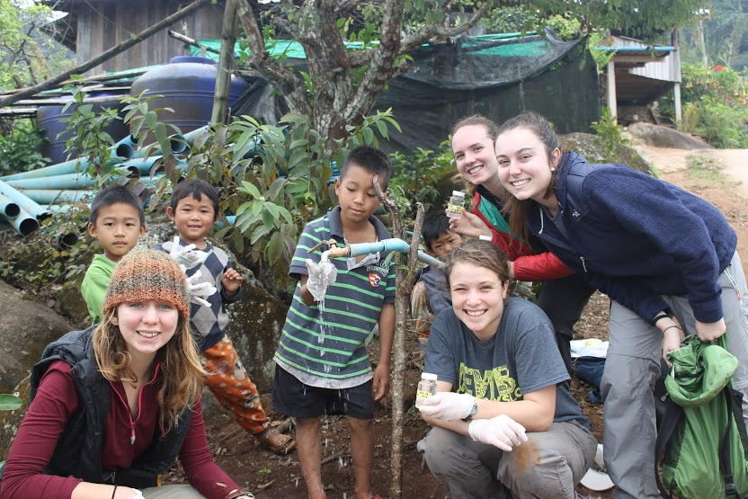 EWB students taking drinking water samples with children from the community of Maejantai.