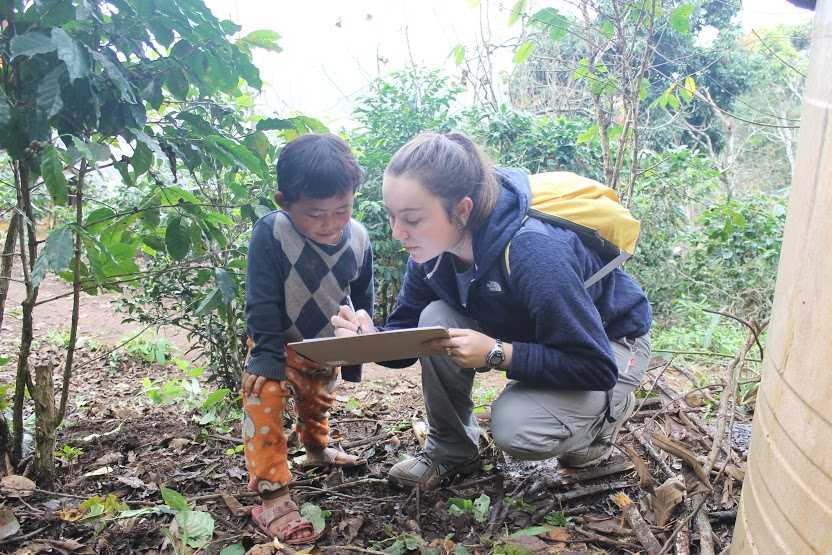 Stefania Beauchamp double-checking her field notes with a boy from Maejantai.