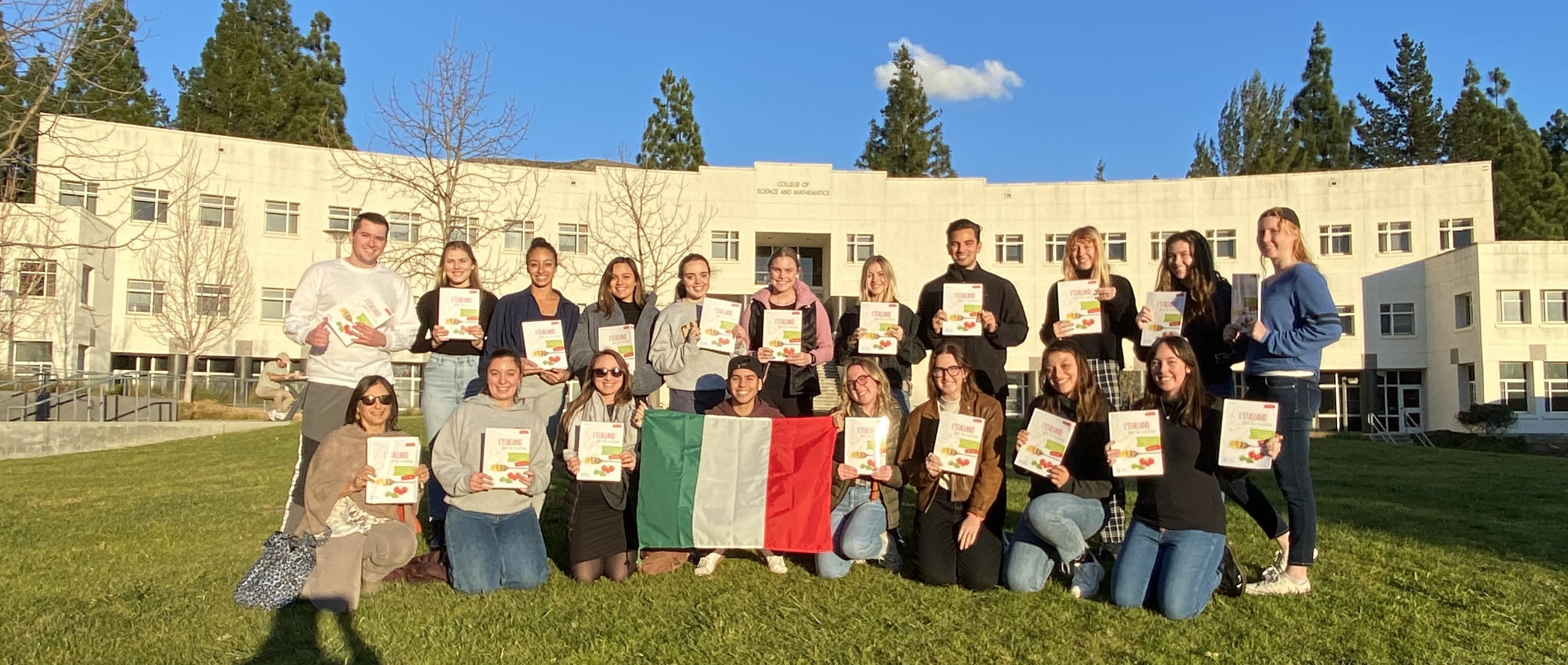 Italian 202 students pose with their textbooks